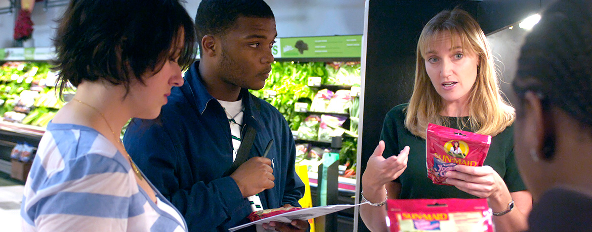 a nutritionist educating students on a grocery store tour