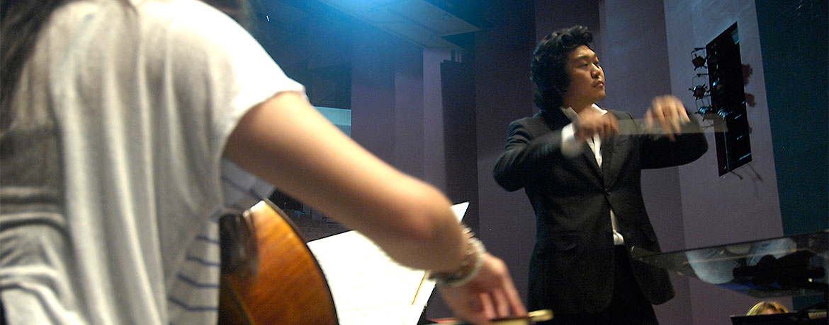 student conducting an orchestra