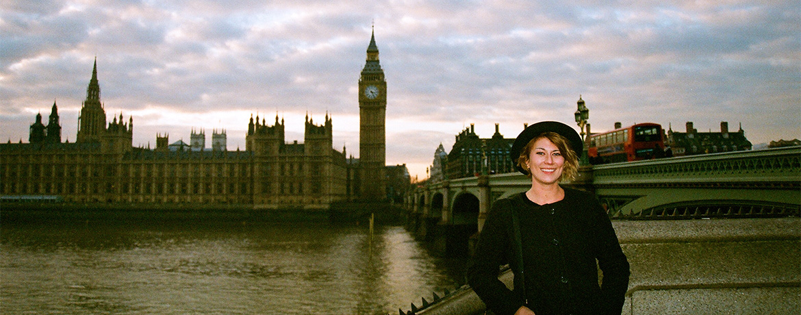 student posing outdoors in front of Big Ben at the Palace of Westminster