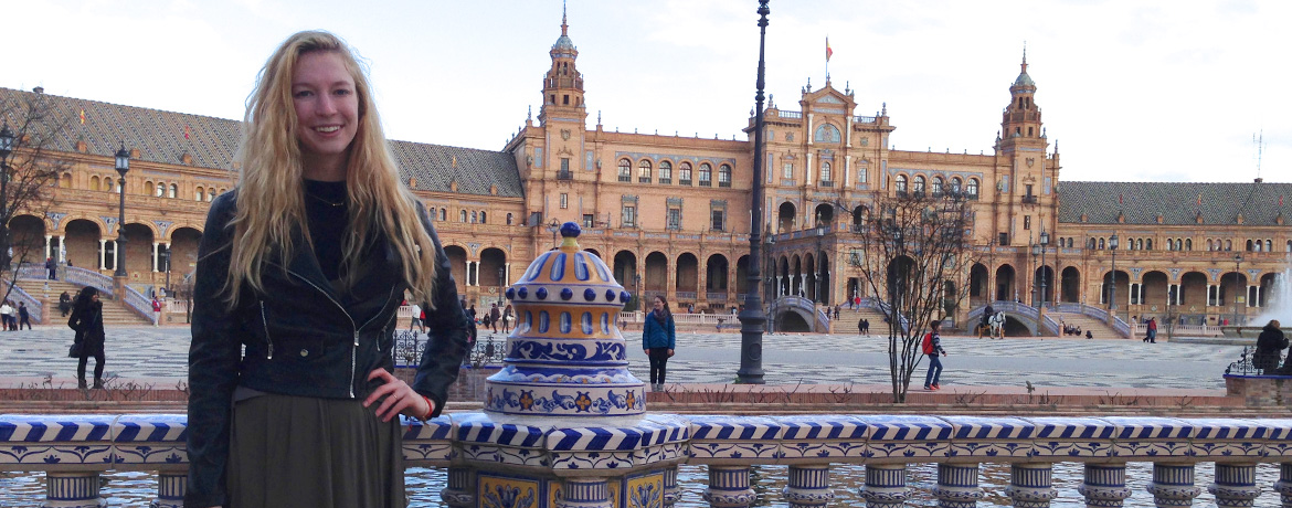 student posing in front of a landmark in Seville Spain