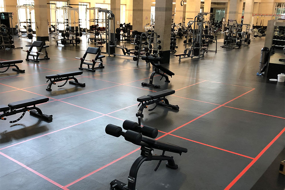 gym equipment spaced out in a 6 x 10 foot grid to allow for physical distancing