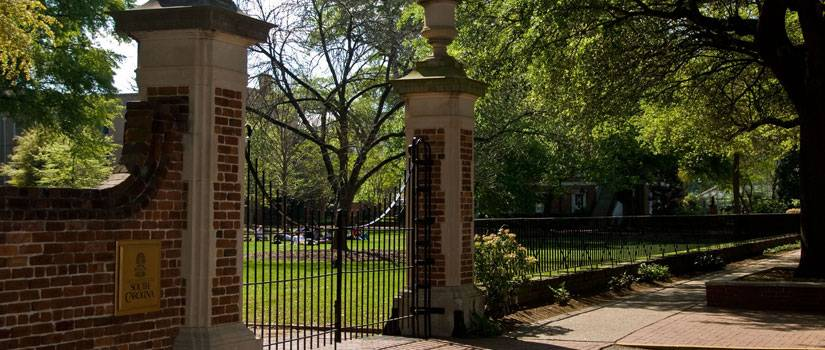 Iron gates with a USC plaque on them.