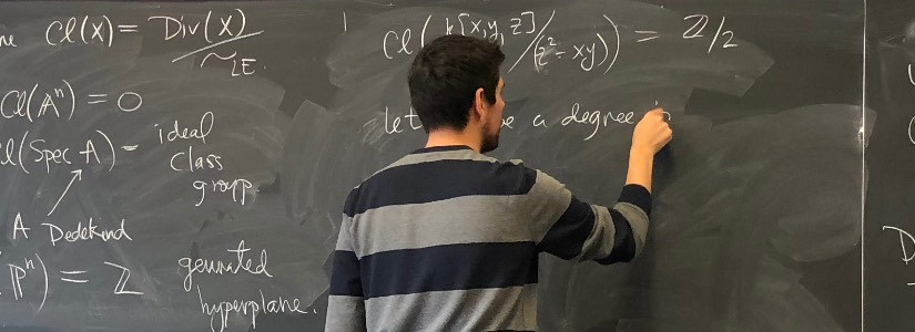 Mathematician at a blackboard