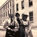 three women in front of a building