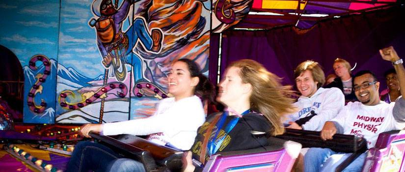 Students enjoy a roller coaster.