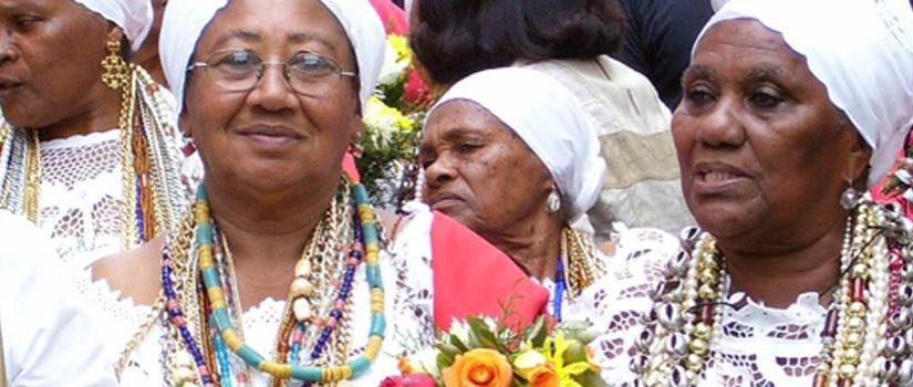 ladies wearing colorful beads and white head scarves