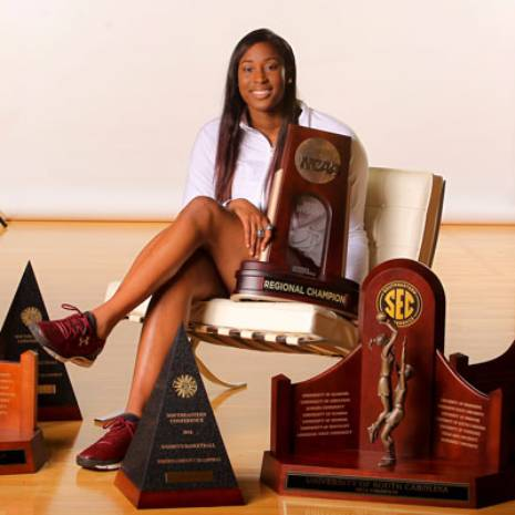 Alumni Alaina Coates with Basketball awards