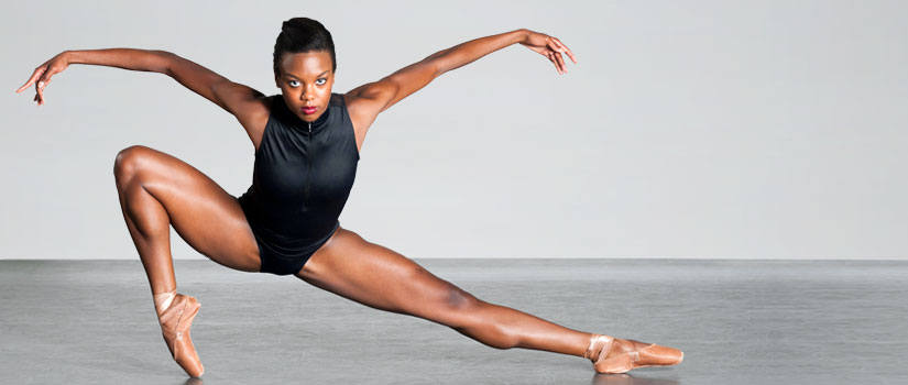 Dancer in a contemporary dance pose in studio