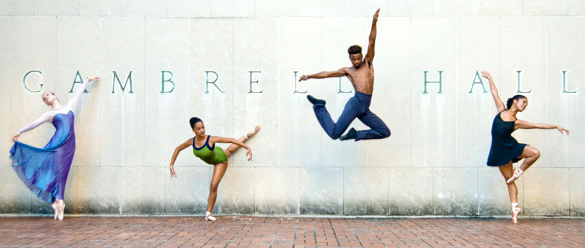 Dancers in various poses in front of Gambrell Hall