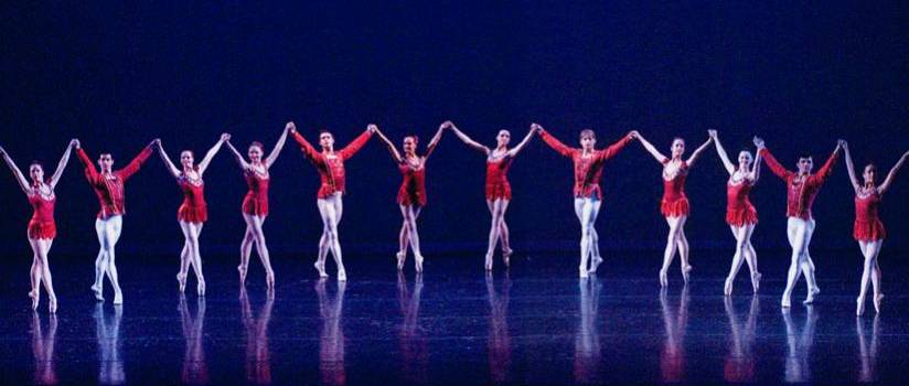 line of ballet dancers in red and white