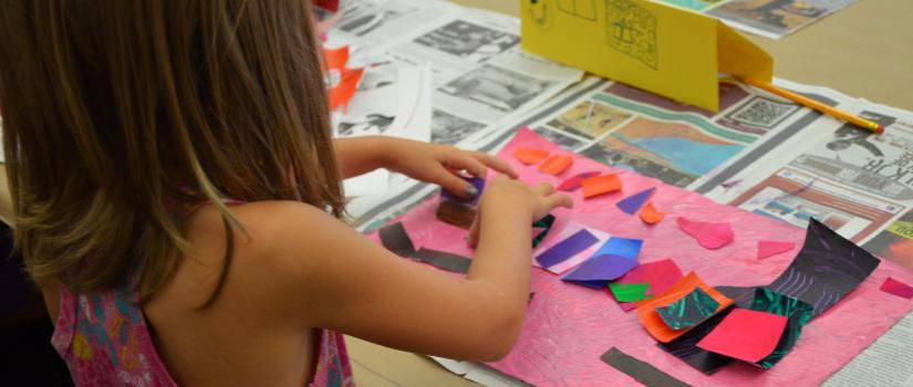 Child working on a collage