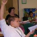 Program participant raises his hand