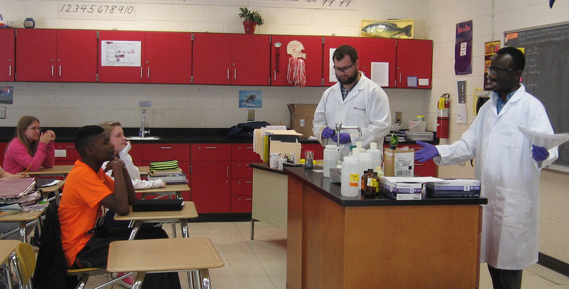Graduate students share their excitement of chemistry with students.