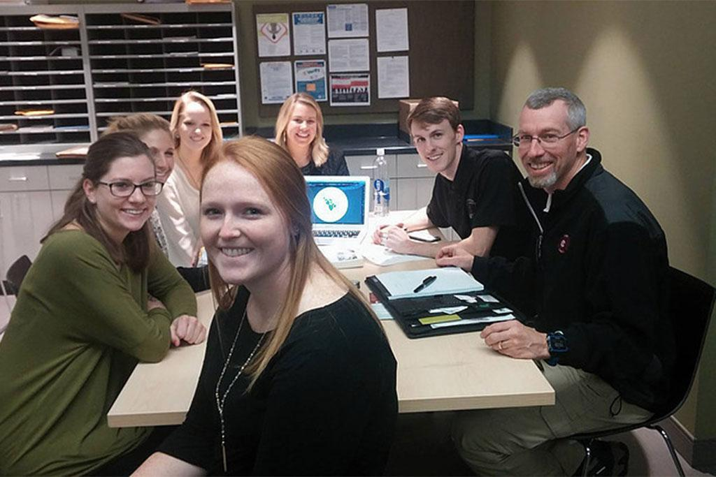 The Carolina Agency's spring 2016 team members (front to back) Sarah Bouchard, Katie Crowley, Abigail Pait, Kristina Baalerud and Kara Neesen with Naturally Carolina representatives Justin Tweito and Tom Syfert. Photo by Gia Haygood (originally published in InterCom - Spring 2016)