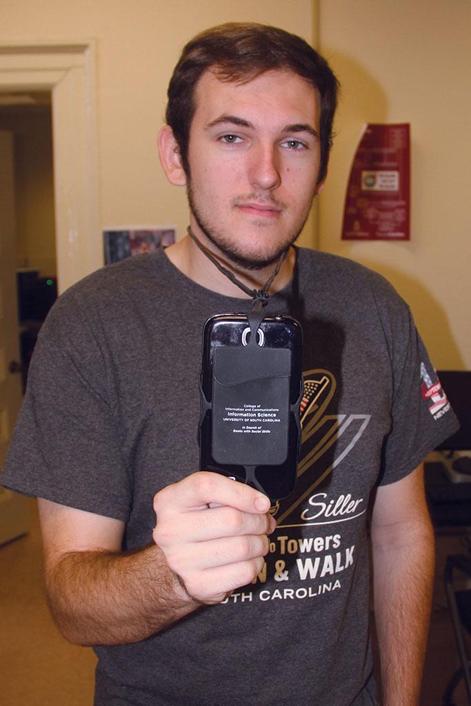SLIS senior Andrew Dunn's phone case carries the rebranding message.