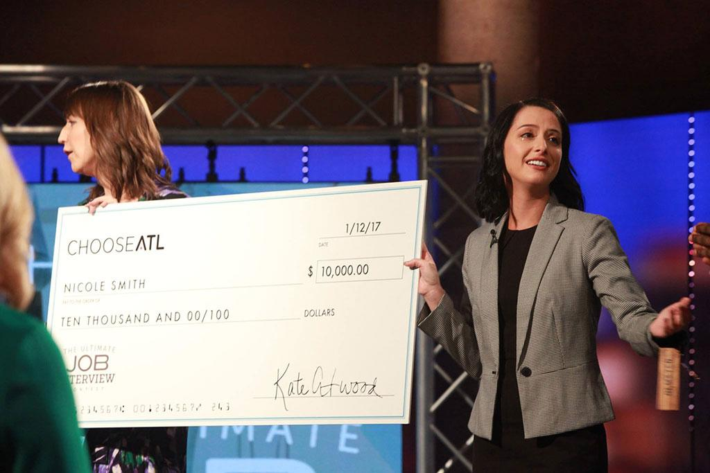 "Nicole is presented with the proverbial ""large check"" when they announced her winner of the contest."