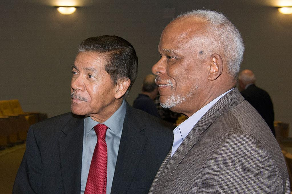 Cecil Williams and Stanley Nelson Jr. talk with audience members before showing and discussing Nelson's civil rights documentary films and Williams' photojournalism on April 1 in the historic Booker T. Washington Auditorium.