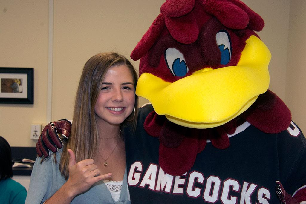 Freshman information science student LeAnne Davison has her first official photo op with Cocky! The Greenville native sees information science as the perfect foundation for a future lawyer.