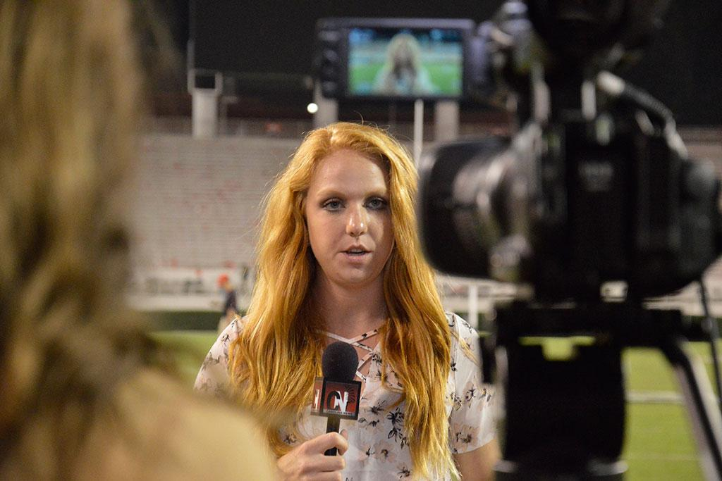 Katie Anger, a senior broadcast journalism major, reporting from the South Carolina/Georgia football game.