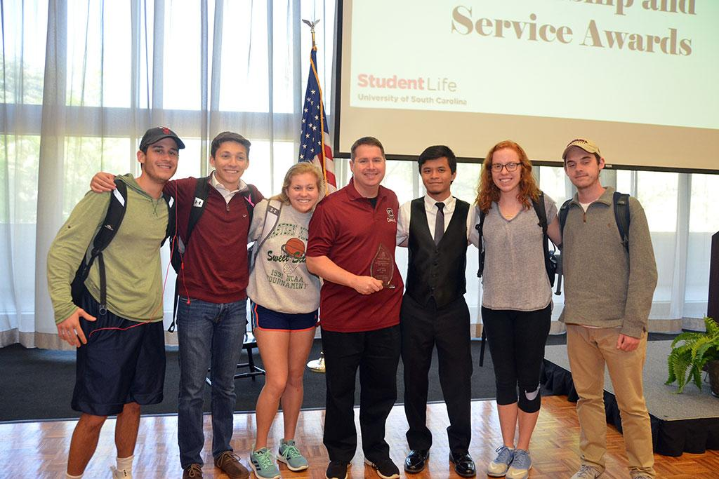 SGTV students celebrate the award with Britt. (l to r) Matt Bumbaca, Jack Taylor, Emma Milner, Britt, Vincent Arceo, Mercy Myers and Spencer Buckler.