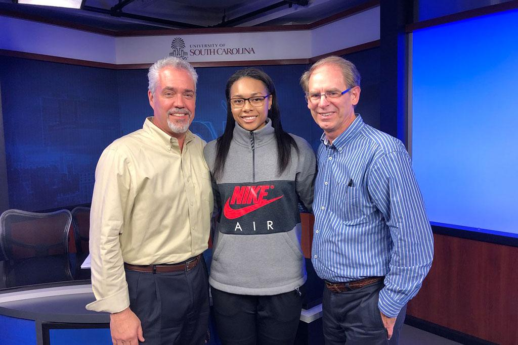 Allisha Gray with senior semester faculty Greg Brannon (left) and Rick Peterson.