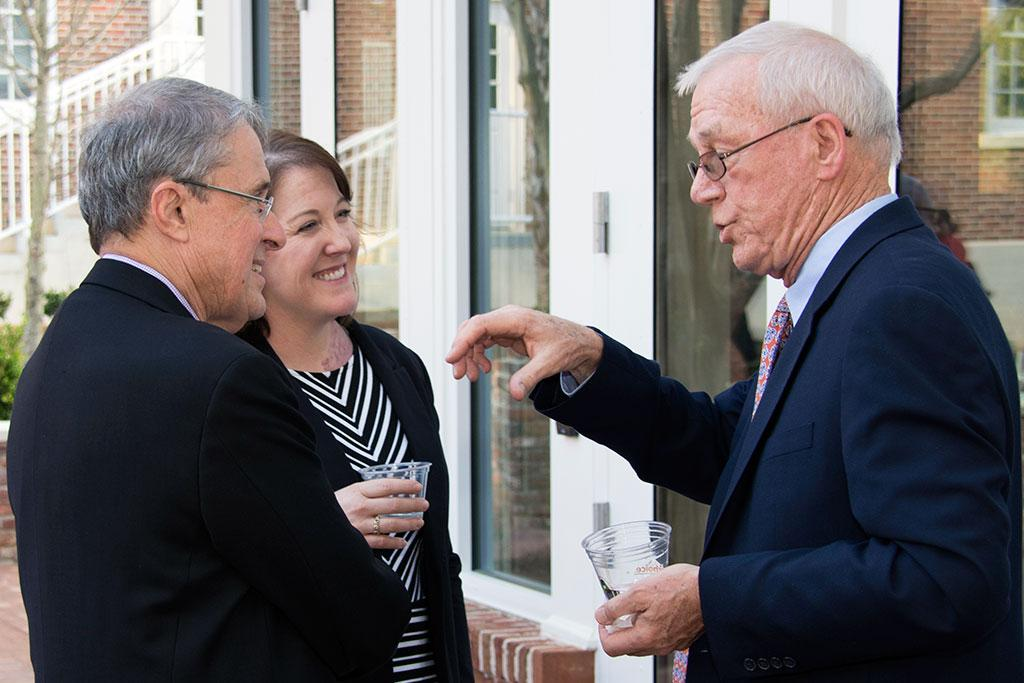 Boston Globe Editor at Large Robby Robinson, right, was honored at a pre-lecture reception. Here he chats with Randy Covington, director of Newsplex, and Cindy Justice, Assistant Dean for Student Services.