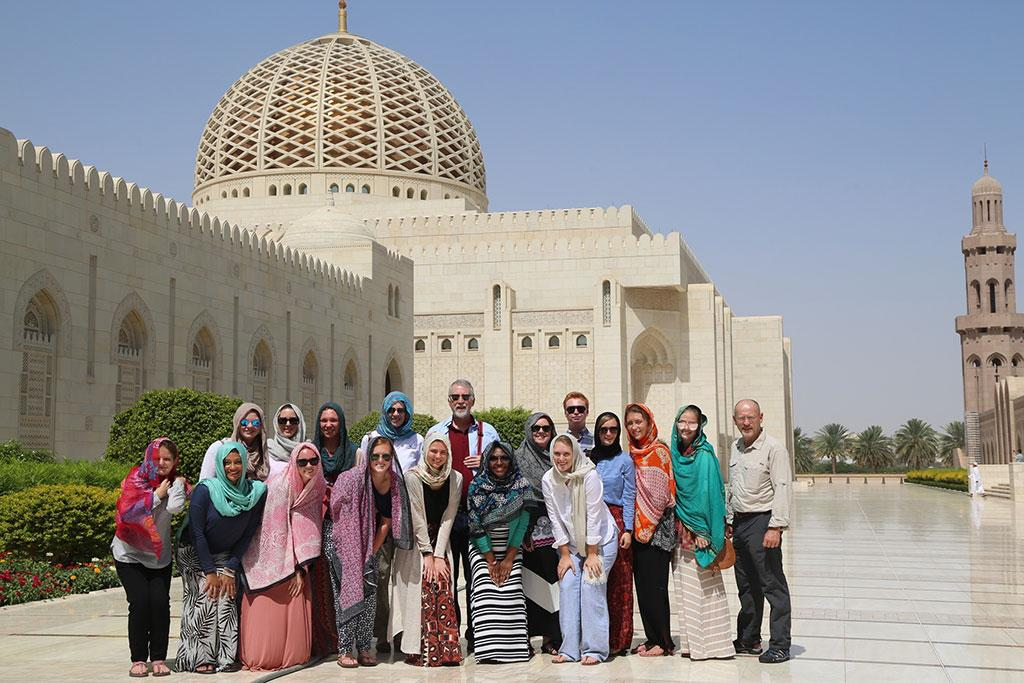 USC Maymester in Oman class outside the Sultan Qaboos Grand Mosque in Muscat, Oman. Pictured back row, center, deputy provost Helen Doerpinghaus and vice provost and director of Global Carolina Allen Miller.