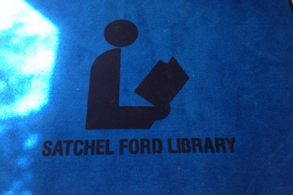 Photos from the Satchel Ford Elementary School Library before and after the flood.