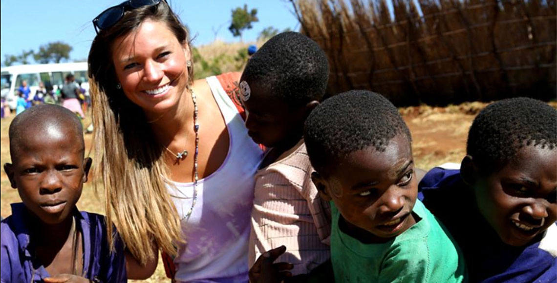 Skylar Evans and children in Africa