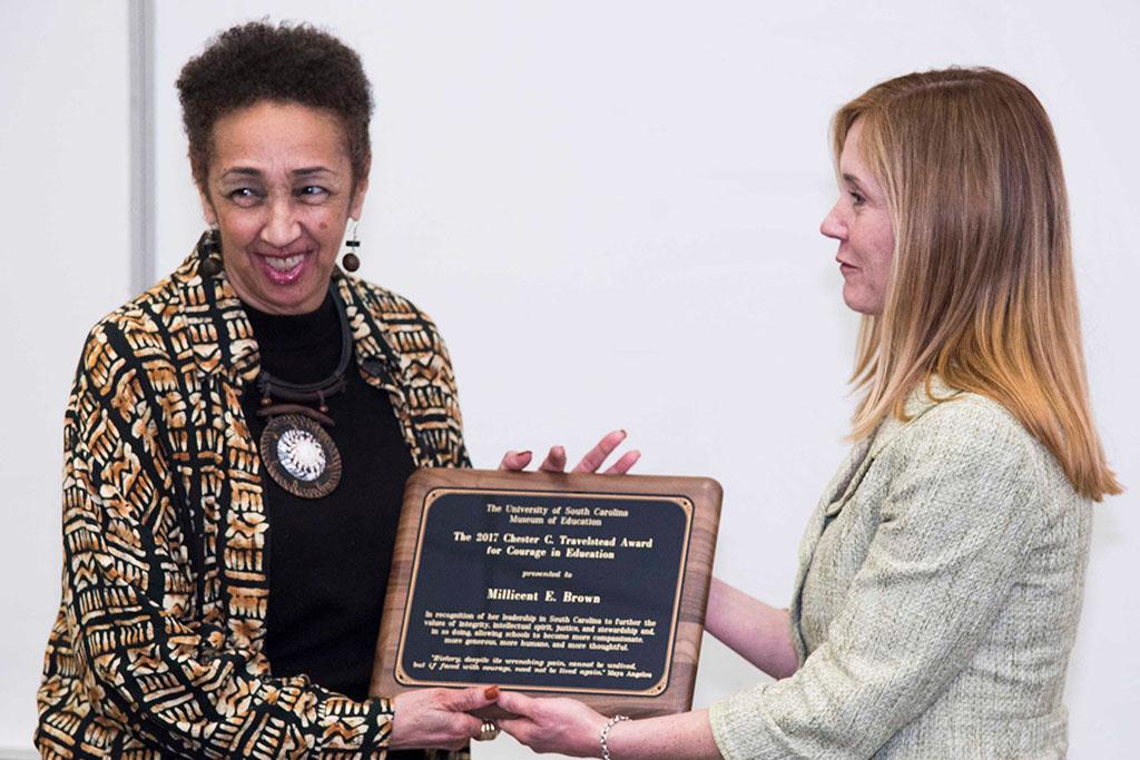L-r: Millicent E. Brown receiving the Travelstead Award from Monique Travelstead McNamara
