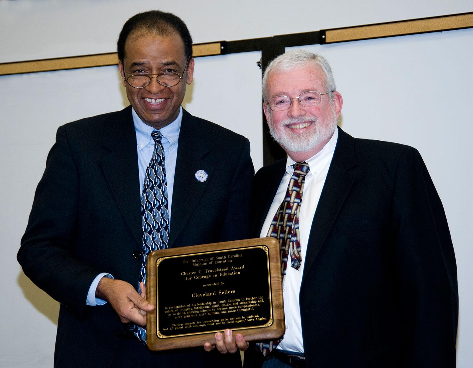 Cleveland L. Sellers Jr. (l) accepting the Travelstead Award for Courage in Education from Coleman Travelstead, the son of Chester C. Travelstead
