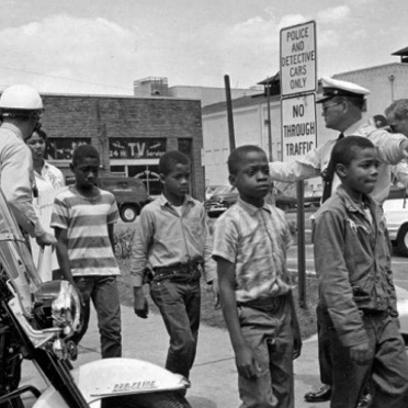 Police in Birmingham, Ala., take a group of black schoolchildren to jail on May 4, 1963, after their arrest for protesting against segregation.