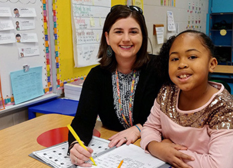 Michelle Taylor and student in classroom