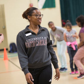 An African American female physical education teacher