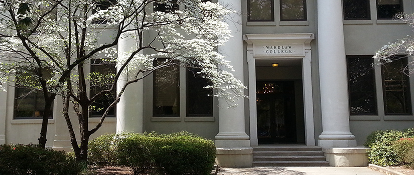 Front entrance of Wardlaw College. A flowering tree is visible on the left.