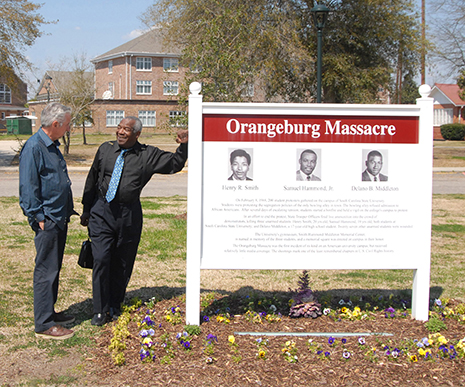 Tom Hayden and Chuck McDew at the Orangeburg Massacre memorial site in Orangeburg.