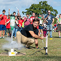 student launches bottle rocket for crowd