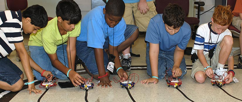 students race robotic cars