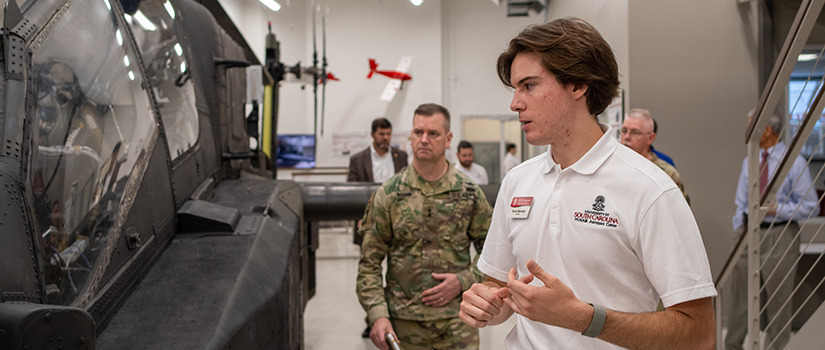 a male student works on a machine in the aerospace center