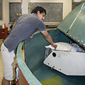 a grad student works with the centrifuge
