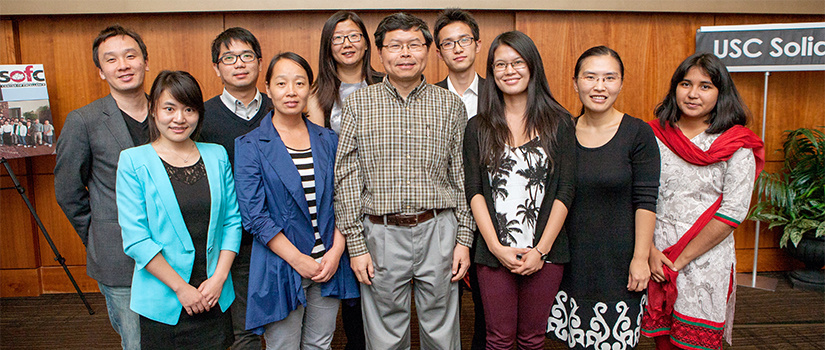 Dr. Huang at a conference with a group of grad students