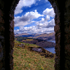"""Window to the Highlands"" in Scotland by Alessandro Berloffa ""This picture was taken from atop Dun na Cuaiche which overlooks the town of Inveraray. At the top of the hill sits a stone monument which is little more than a small room in which I took this picture."""