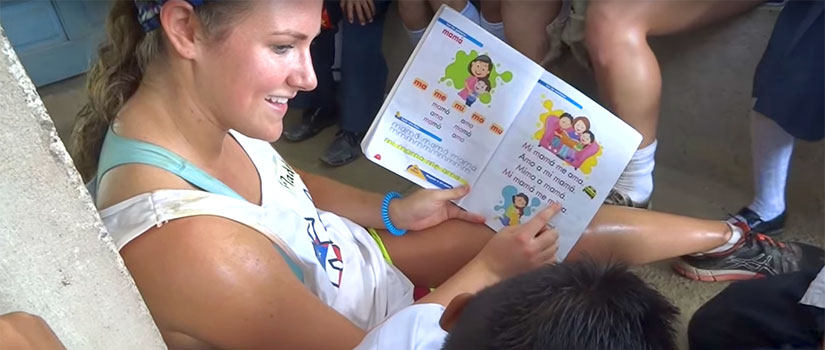 student reading to a boy in Honduras