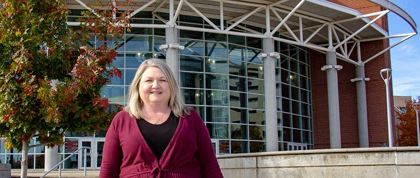 Michelle Knight stands in front of Colonial Life Arena, Columbia's premiere sport and entertainment venue, on a beautiful sunny day.