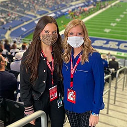 Maddie Ballengee stands with a colleague during a Dallas Cowboys game