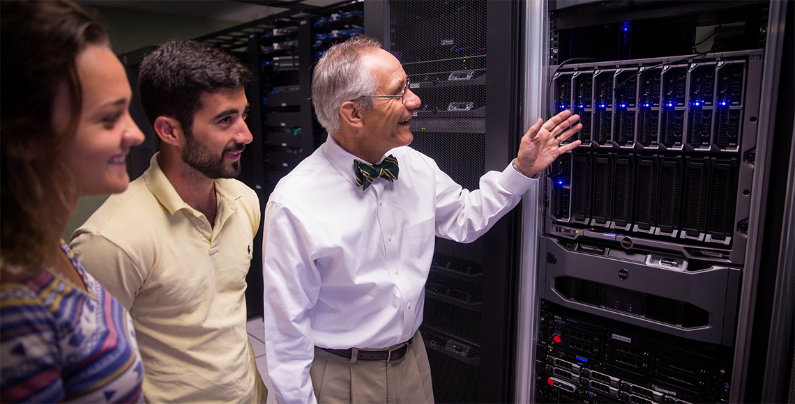Dr. Brookshire shows students new servers in IT-oLogy