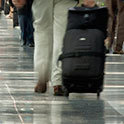 Thumbnail of Tourist pulling luggage in an airport
