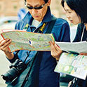 Thumbnail of Chinese tourists viewing a map
