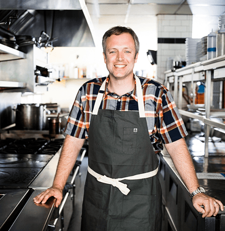William S. Dissen poses in a commercial kitchen at one of his restaurants.