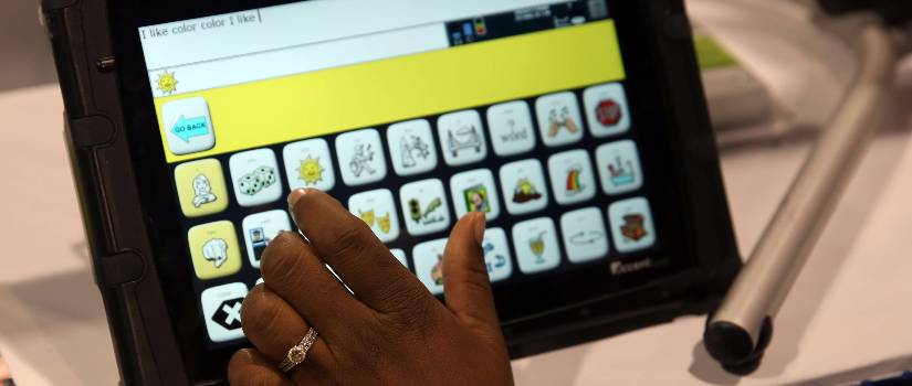 Hand using a tablet.